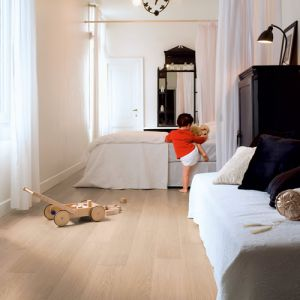 Quickstep Impressive Ultra White Varnished Oak IMU3105 Waterproof Laminate Flooring (12mm)