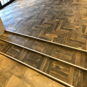 Engadin Distressed Oak Herringbone Engineered Parquet Wood Flooring 18/5mm x 400mm